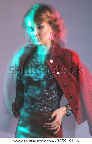 Unusual mixed light studio portrait of young woman - stock photo