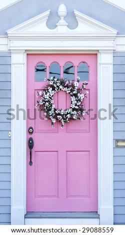 unusual pink door with wreath - stock photo