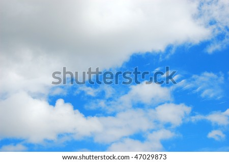 Unusual white and gray clouds against a brilliant blue sky - stock photo
