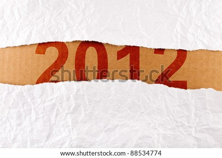 Unwrapping a brand new year 2012 - with copy space - stock photo