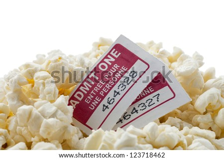 """Up close image of pop corn and movie tickets for more fun and enjoyment """"admit one"""" - stock photo"""