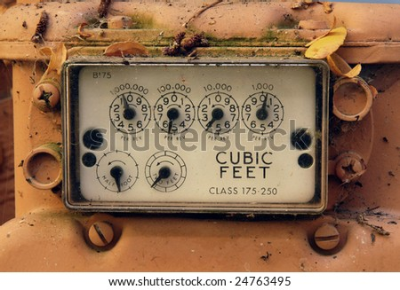 Up close shot of an old utilities meter. - stock photo
