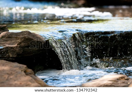 Up-close view of stream waterfall - stock photo