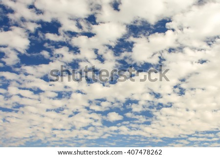Up in the air - the beautiful sunny sky with some clouds - stock photo