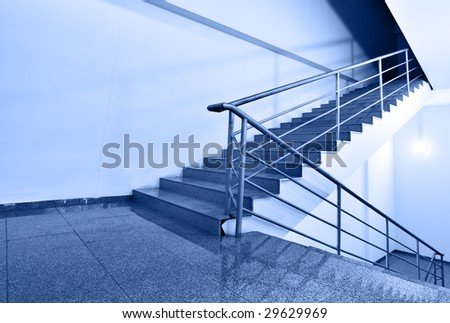 Up or down? - Wide angle shot of stairs toned ib blue color - stock photo