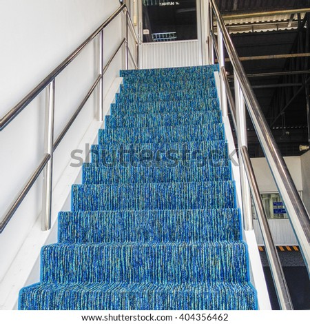 Up the Ladder, fixed ladder to the Office, way down concept background, Mixed Blue color carpets