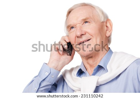 Up with times. Portrait of happy senior man smiling at camera while standing against white background  - stock photo