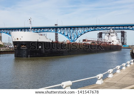 Upbound On The Cuyahoga:  A Great Lakes bulk carrier moves slowly upbound on the Cuyahoga River at Cleveland, Ohio