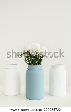 Upcycled jars painted with chalk paint - stock photo