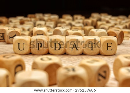 UPDATE word written on wood block - stock photo