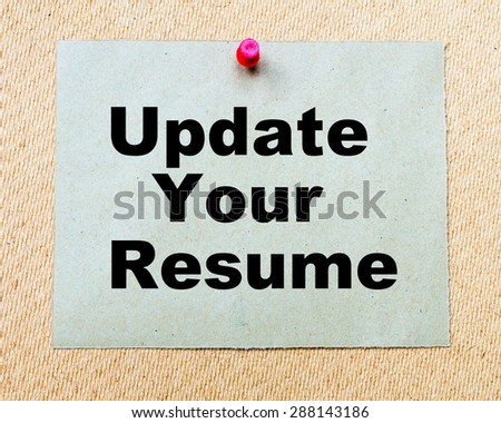 Update Your Resume written on paper note pinned with red thumbtack on wooden board. Business conceptual Image - stock photo