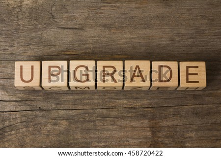 upgrade text on wooden cubes - stock photo