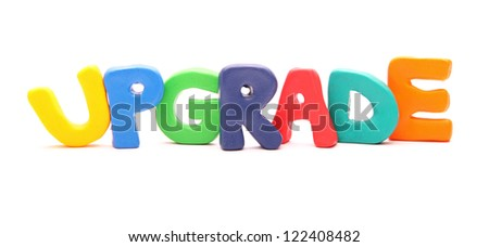 UPGRADE - webwords of plasticine letters standing isolated on white - stock photo