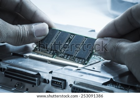 Upgrading RAM memory card on laptop computer motherboard - stock photo