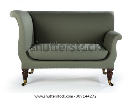 Upholstered green sofa retro style isolated on white with clipping path