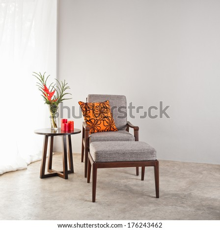 Upholstered stool in grey - stock photo