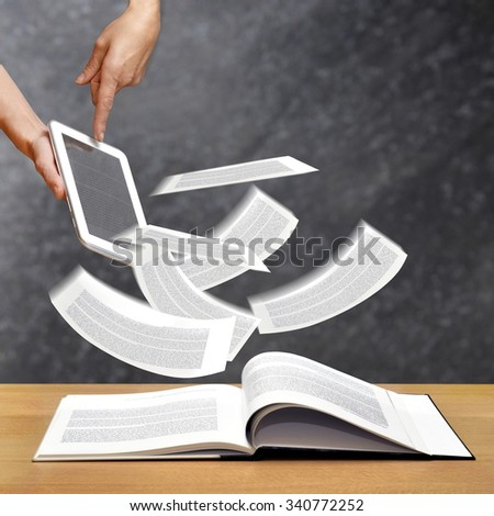upload and download files concept from ebook reader - stock photo