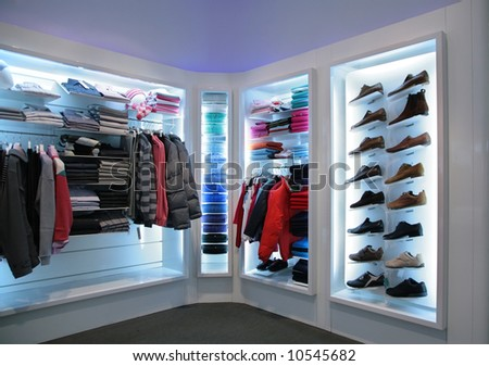 upper clothes and shoes in shop - stock photo