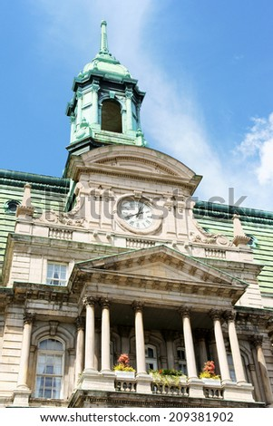Upper detail of the facade of Montreal City Hall, Quebec, Canada. It was built by Henri-Maurice Perrault and Alexander Cowper Hutchison, between 1872 and 1878 in Second Empire Style.