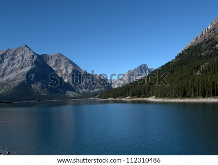 Upper  Kananaskis Lake with Mount Lyautey and Mount Putnik in the background as viewed at  Peter Lougheed Provincial Park in Alberta's Kananaskis Country. - stock photo