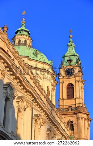 Upper part and tall belfry of Saint Nicholas Church (Cathedral), Prague, Czech Republic - stock photo