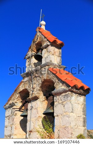 Upper stone structure and bells of orthodox monastery from the Adriatic sea area - stock photo
