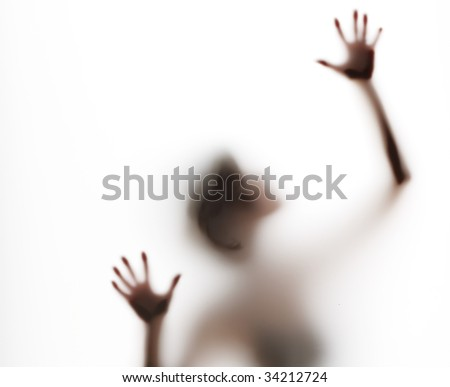 upper torso of abstract, semi-obscured figure with arms raised - stock photo