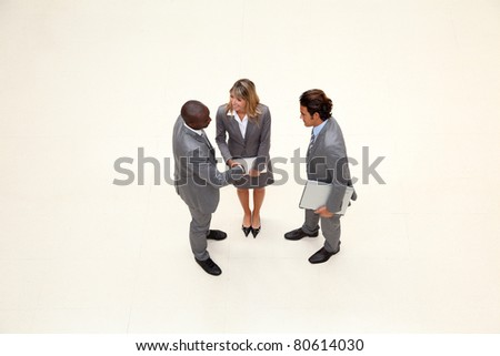 Upper view of business people meeting in hall - stock photo