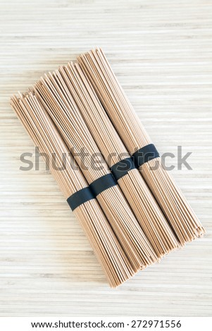 upper view of four stacked bundles of Japanese buckwheat soba noodles