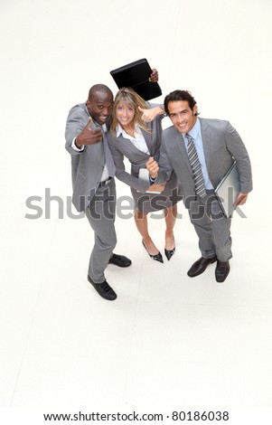 Upper view of happy business team - stock photo