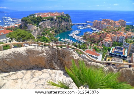 Upper view to the old district of Monaco-Ville surrounded by the sea, Monaco, French Riviera - stock photo