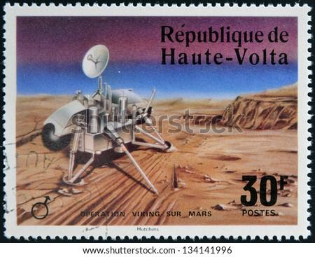 UPPER VOLTA - CIRCA 1976: A stamp printed in Upper Volta dedicated to Operation Viking Sur Mars, circa 1975. - stock photo