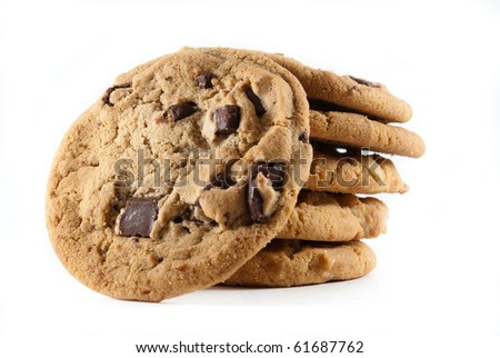 Upright cookies against a stack of chocolate chip cookies on a white isolated background - stock photo