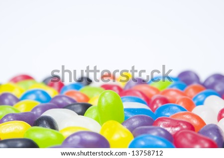 upright green jellybean standing out in crowd