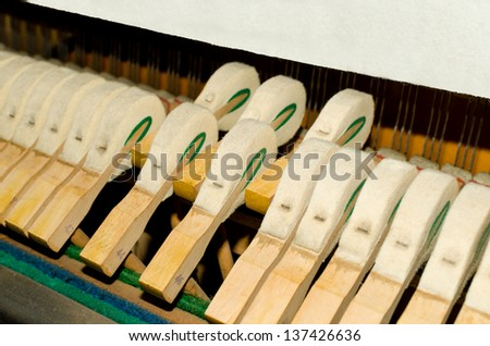 Upright piano hammers detail - stock photo