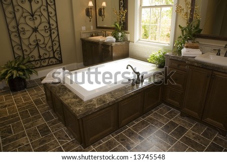 Upscale bathroom with a modern tub and tile floor.