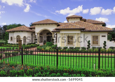 Upscale home in Central Florida with blue sky - stock photo