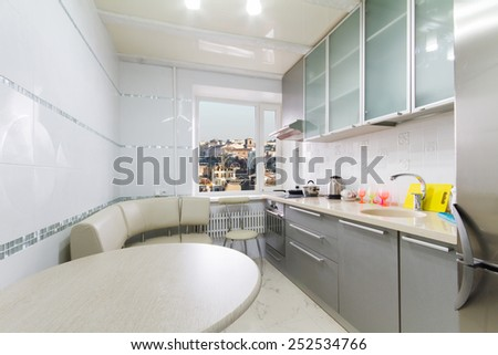 Upscale kitchen in a modern home overlooking the city - stock photo