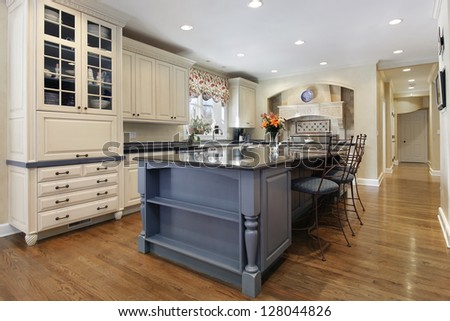Upscale kitchen with a gray cabinet granite island - stock photo