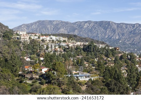 Upscale Los Angeles County hillside homes with San Gabriel mountains backdrop. - stock photo