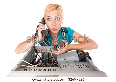 upset blond woman having problems with computer phoning support - stock photo