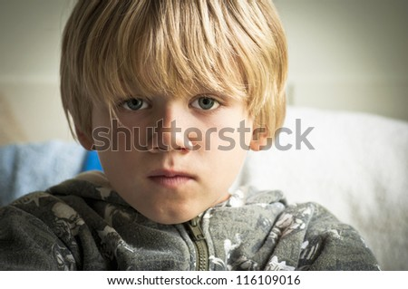 Upset boy with sad eyes - stock photo
