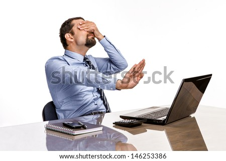upset businessman with eyes closed by hand is against xxx & porno on-line / frustrated businessman close his eyes by hand, turned away from the laptop screen - isolated on white background  - stock photo