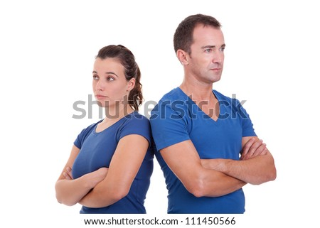 upset couple, back to back , isolated on white, studio shot