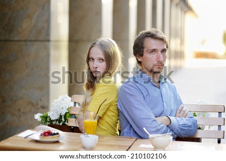 Upset couple not talking to each other after argument  - stock photo
