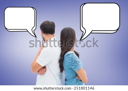 Upset couple not talking to each other after fight against purple vignette - stock photo