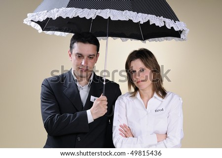 upset fired man and woman thinking - stock photo