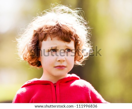 upset five year old girl in the summer park - stock photo