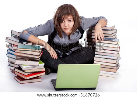 Upset girl in front of laptop, surrounded by books - stock photo