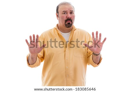 Upset man guarding his privacy holding up his hands in a stop or halt gesture indicating he has had enough, part of a series on body language, isolated on white - stock photo